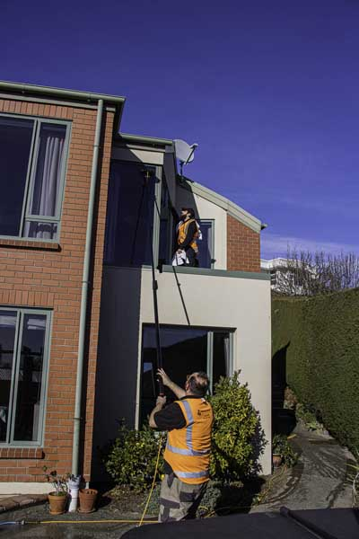 Window cleaning: different methods used to access different parts of the house.
